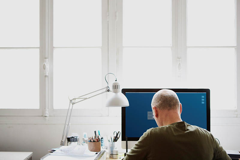 man working from home office